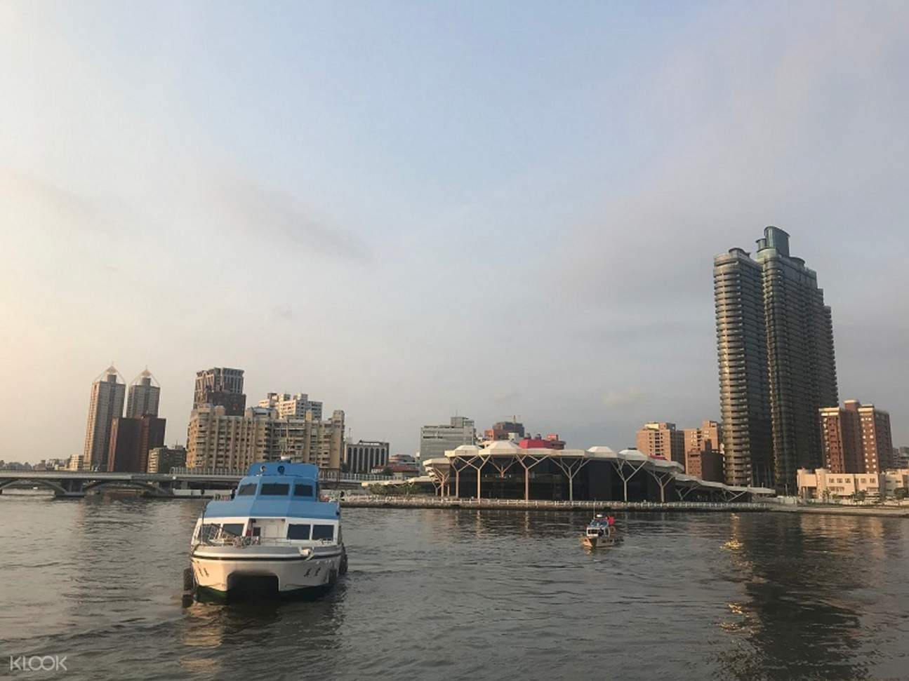 boat and city skyline in kaohsiung harbour